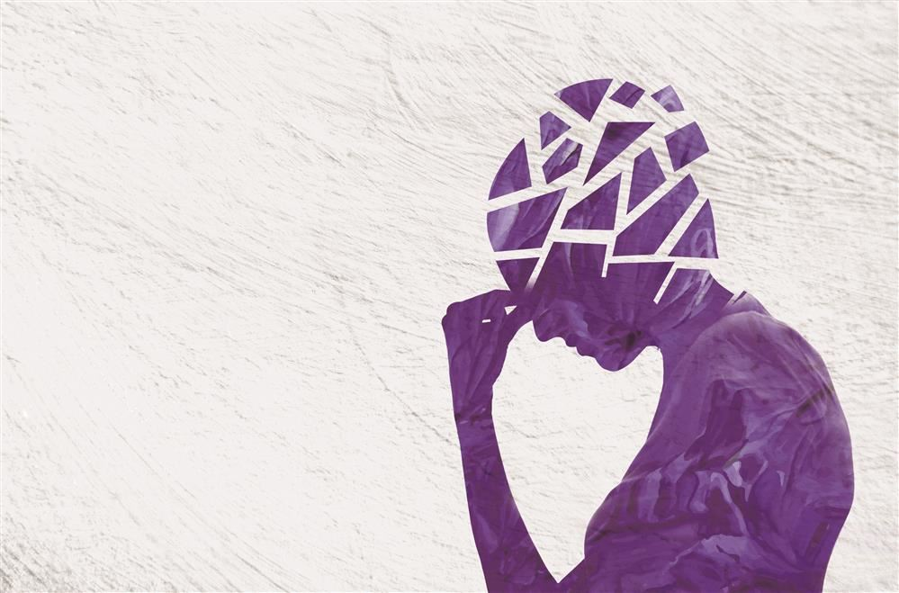 painted purple silhouette of a person the head area is in shattered pieces.